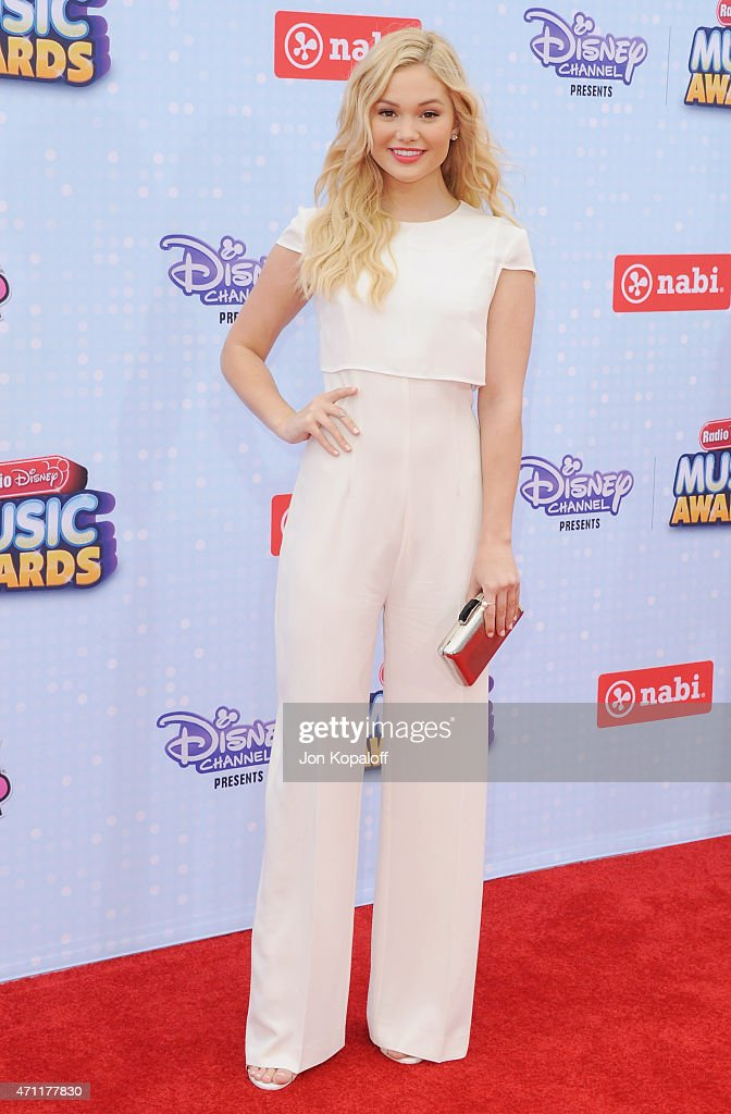 Actress Olivia Holt arrives at the 2015 Radio Disney Music Awards at Nokia Theatre LA Live on April 25 2015 in Los Angeles California