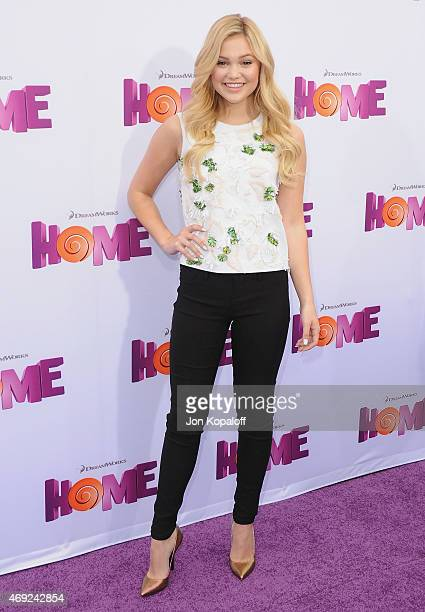 Actress Olivia Holt arrives at the Los Angeles Premiere 'HOME' at Regency Village Theatre on March 22 2015 in Westwood California
