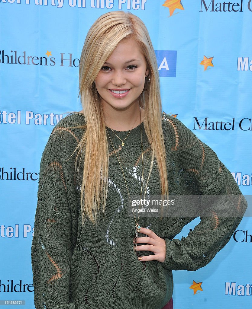 Actress Olivia Holt arrives to the 'Mattel Party on the Pier' benefiting Mattel Children's Hospital UCLA at Pacific Park on the Santa Monica Pier on October 21, 2012 in Santa Monica, California.