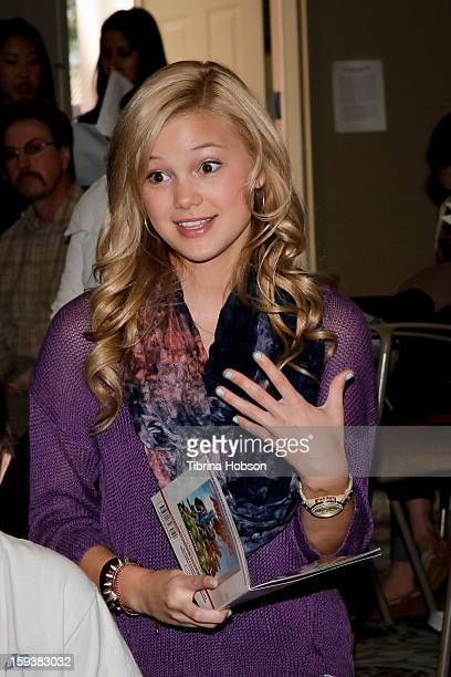 Actress Olivia Holt reads to a group of children at the 'Reading With Marvel Comics CloseUp' kickoff event at the Burbank Public Library on January...