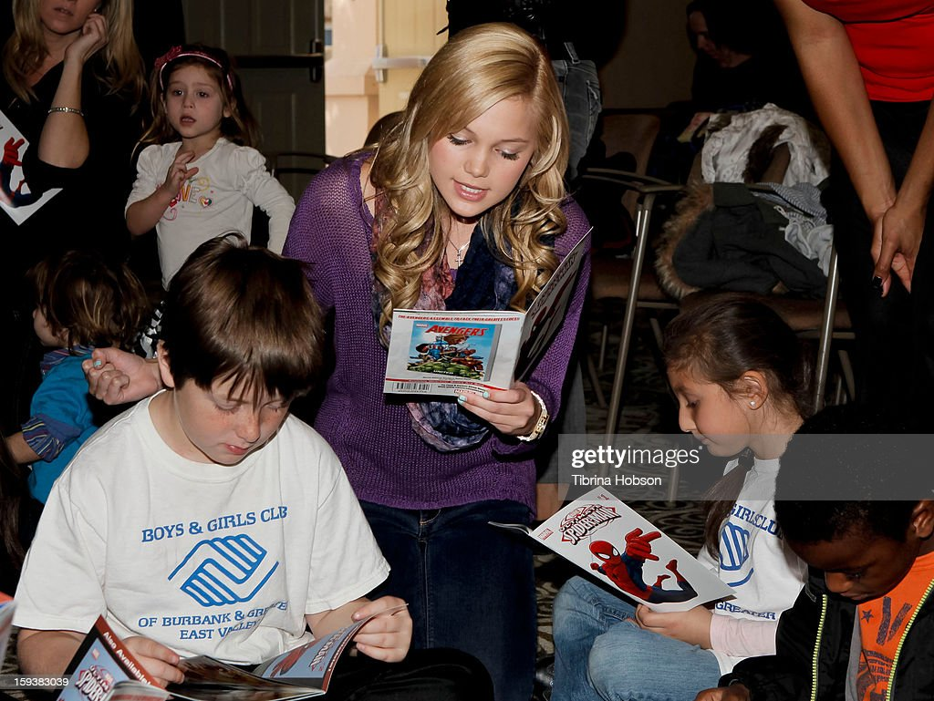 Actress Olivia Holt reads to a group of children at the 'Reading With: Marvel Comics Close-Up' kick-off event at the Burbank Public Library on January 12, 2013 in Burbank, California.