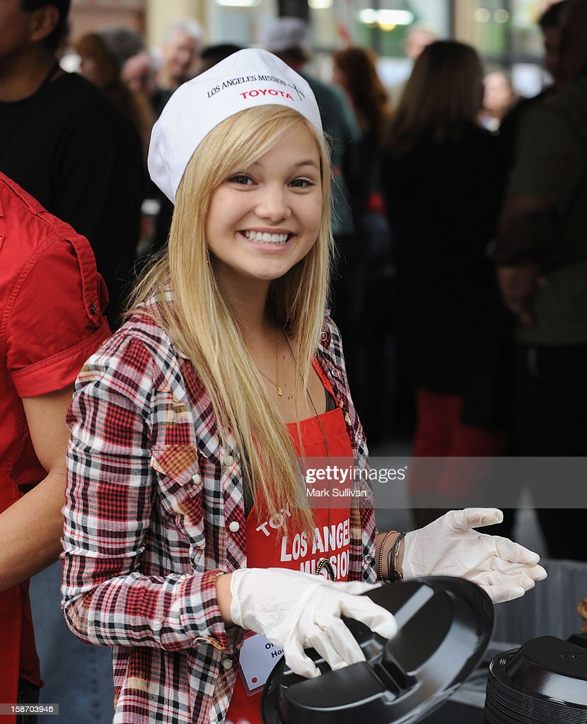 Actress Olivia Holt serves food during the Los Angeles Mission Christmas Eve meal for the homeless at Los Angeles Mission on December 24, 2012 in Los Angeles, California.