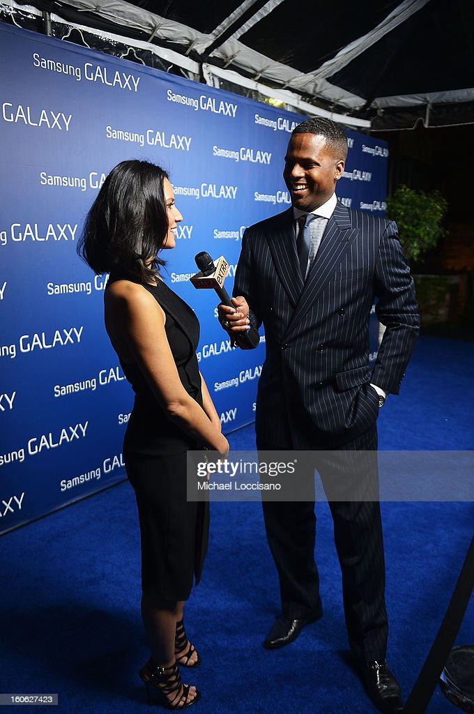 """Actress Olivia Munn (L) and AJ Calloway at the Samsung Galaxy """"Shangri-La"""" Party on February 2, 2013 in New Orleans, Louisiana."""