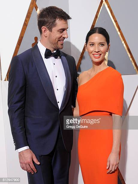 Actress Olivia Munn and NFL player Aaron Rodgers arrive at the 88th Annual Academy Awards at Hollywood Highland Center on February 28 2016 in...