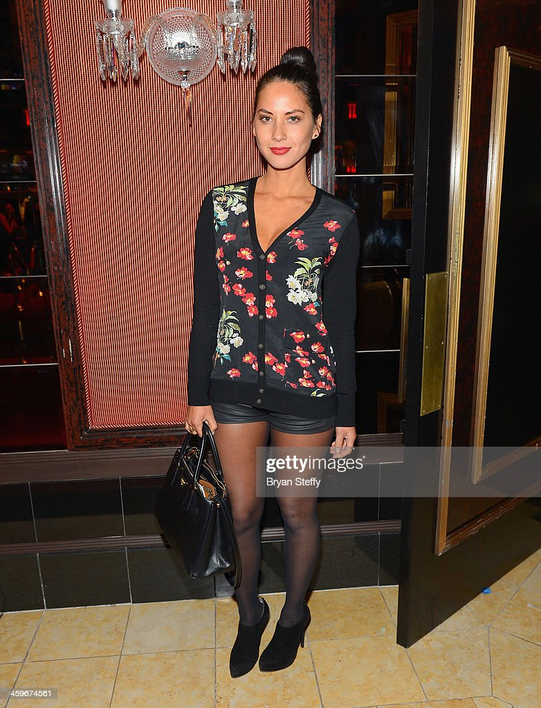 Actress Olivia Munn arrives at Beacher's Madhouse Las Vegas at the MGM Grand Hotel/Casino on December 28, 2013 in Las Vegas, Nevada.