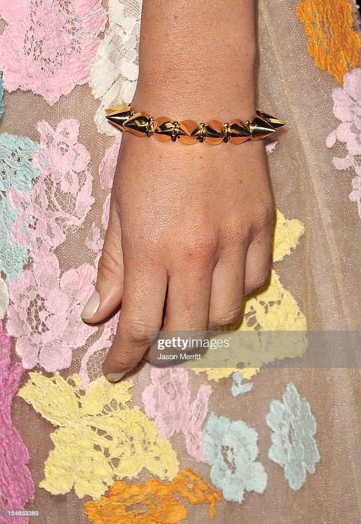 Actress Olivia Munn (jewelry detail) arrives at Elyse Walker presents the 8th annual Pink Party hosted by Michelle Pfeiffer to benefit Cedars-Sinai Women's Cancer Program held at