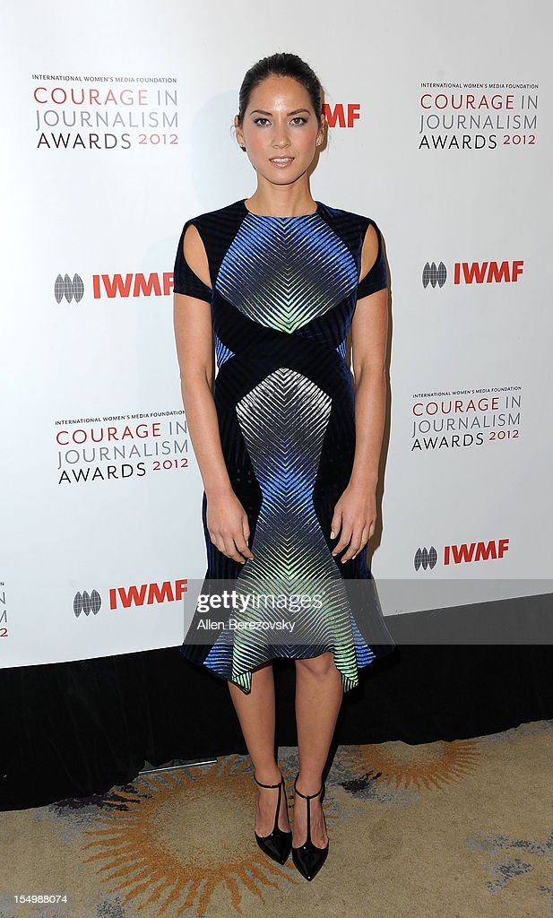 Actress <a gi-track='captionPersonalityLinkClicked' href=/galleries/search?phrase=Olivia+Munn&family=editorial&specificpeople=598969 ng-click='$event.stopPropagation()'>Olivia Munn</a> arrives at the 2012 Courage in Journalism Awards hosted by the International Women's Media Foundation held at the Beverly Hills Hotel on October 29, 2012 in Beverly Hills, California.