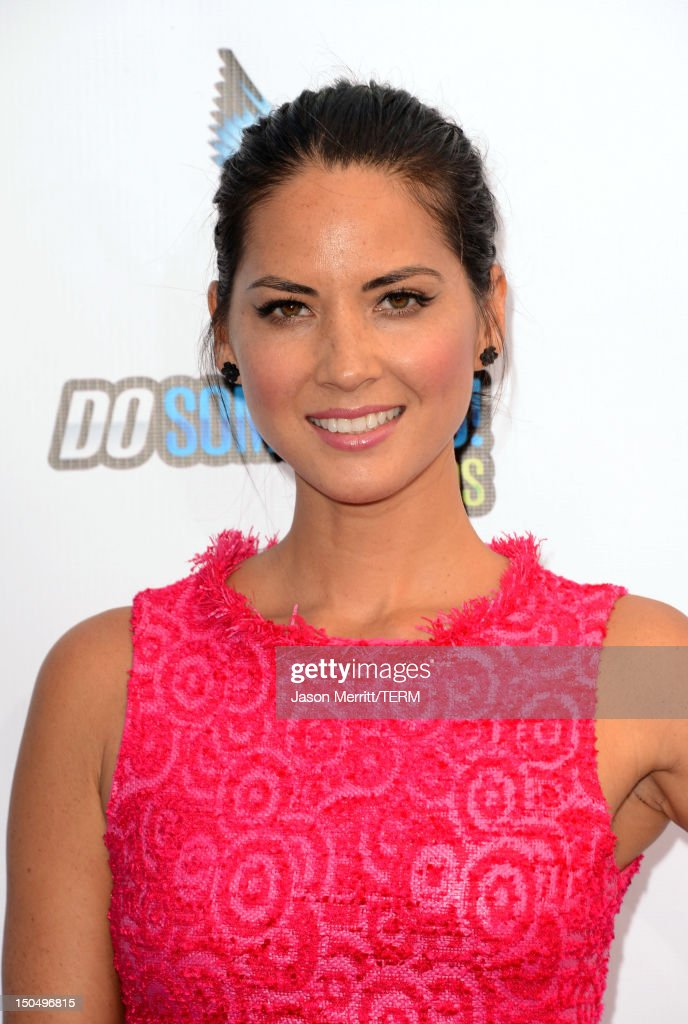 Actress <a gi-track='captionPersonalityLinkClicked' href=/galleries/search?phrase=Olivia+Munn&family=editorial&specificpeople=598969 ng-click='$event.stopPropagation()'>Olivia Munn</a> arrives at the 2012 Do Something Awards at Barker Hangar on August 19, 2012 in Santa Monica, California.