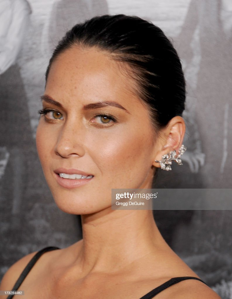 Actress <a gi-track='captionPersonalityLinkClicked' href=/galleries/search?phrase=Olivia+Munn&family=editorial&specificpeople=598969 ng-click='$event.stopPropagation()'>Olivia Munn</a> arrives at the Los Angeles Season 2 premiere of HBO's series 'The Newsroom' at Paramount Studios on July 10, 2013 in Hollywood, California.