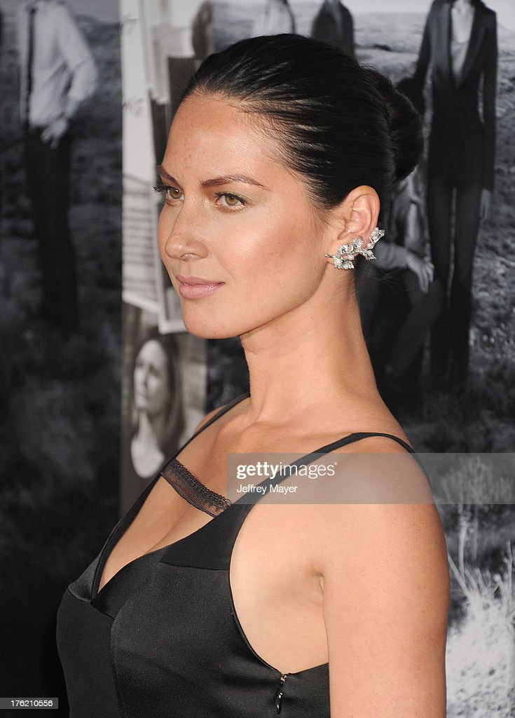 Actress Olivia Munn arrives at the Los Angeles Season 2 Premiere Of HBO's Series 'The Newsroom' at Paramount Studios on July 10, 2013 in Hollywood, California.