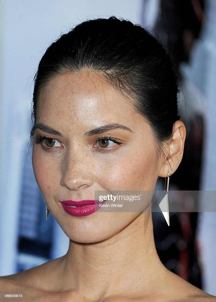 Actress Olivia Munn arrives at the premiere of Columbia Pictures' 'Robocop' at TCL Chinese Theatre on February 10, 2014 in Hollywood, California.