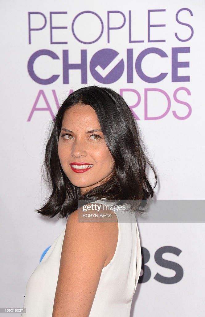 Actress Olivia Munn arrives for the 2013 People's Choice Awards at the Nokia Theatre in Los Angeles, California, January 09, 2013. AFP PHOTO / Robyn Beck