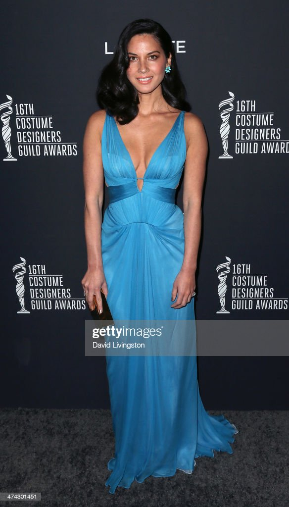 Actress <a gi-track='captionPersonalityLinkClicked' href=/galleries/search?phrase=Olivia+Munn&family=editorial&specificpeople=598969 ng-click='$event.stopPropagation()'>Olivia Munn</a> attends the 16th Costume Designers Guild Awards with presenting sponsor Lacoste at The Beverly Hilton Hotel on February 22, 2014 in Beverly Hills, California.