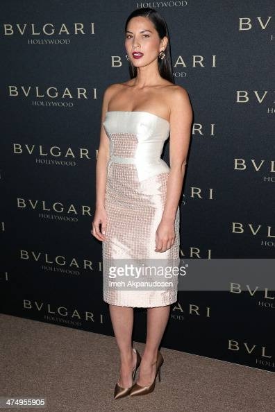 Actress Olivia Munn attends the BVLGARI 'Decades of Glamour' Oscar Party at Soho House on February 25 2014 in West Hollywood California