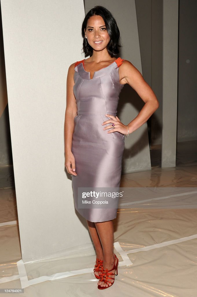 Actress <a gi-track='captionPersonalityLinkClicked' href=/galleries/search?phrase=Olivia+Munn&family=editorial&specificpeople=598969 ng-click='$event.stopPropagation()'>Olivia Munn</a> attends the Carolina Herrera Spring 2012 fashion show during Mercedes-Benz Fashion Week at The Theater at Lincoln Center on September 12, 2011 in New York City.