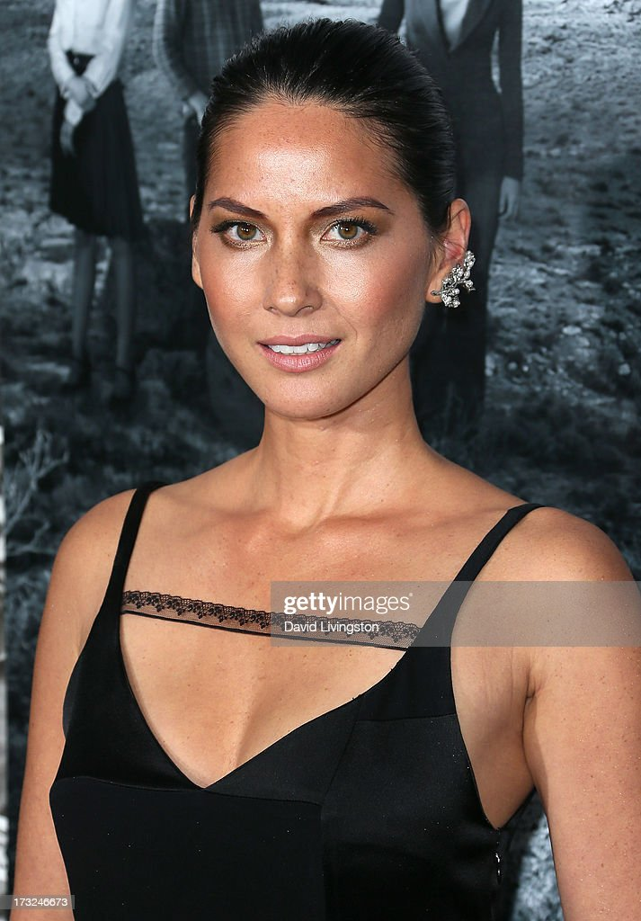Actress <a gi-track='captionPersonalityLinkClicked' href=/galleries/search?phrase=Olivia+Munn&family=editorial&specificpeople=598969 ng-click='$event.stopPropagation()'>Olivia Munn</a> attends the premiere of HBO's 'The Newsroom' Season 2 at the Paramount Theater on the Paramount Studios lot on July 10, 2013 in Hollywood, California.