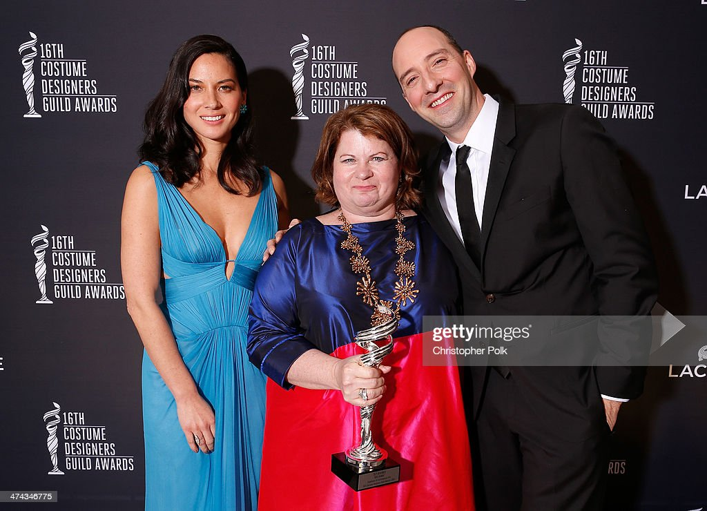Actress Olivia Munn, Costume Designer Suzy Benzinger, winner of Excellence in Costume Design in Contemporary Film, Blue Jasmine, actor Tony Hale attend the 16th Costume Designers Guild Awards with presenting sponsor Lacoste at The Beverly Hilton Hotel on February 22, 2014 in Beverly Hills, California.