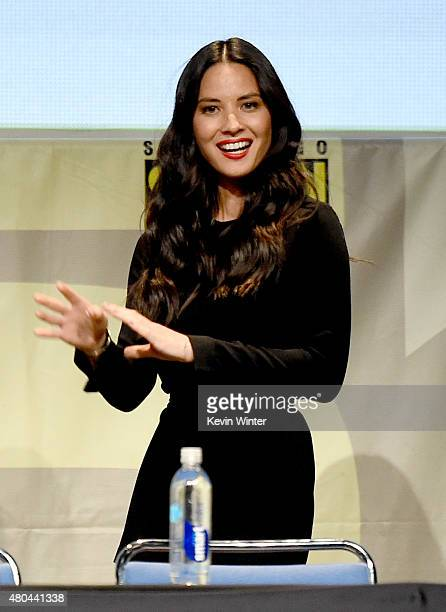Actress Olivia Munn from 'XMen Apocalypse' walks onstage at the 20th Century FOX panel during ComicCon International 2015 at the San Diego Convention...