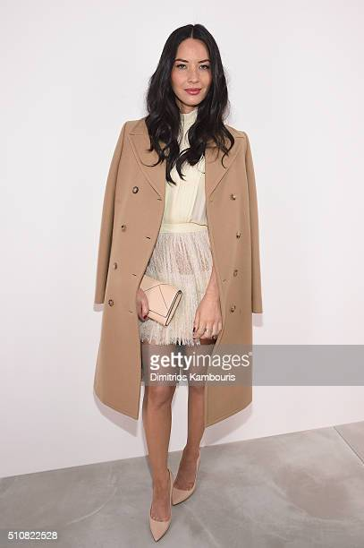 Actress Olivia Munn poses backstage at the Michael Kors Fall 2016 Runway Show during New York Fashion Week The Shows at Spring Studios on February 17...