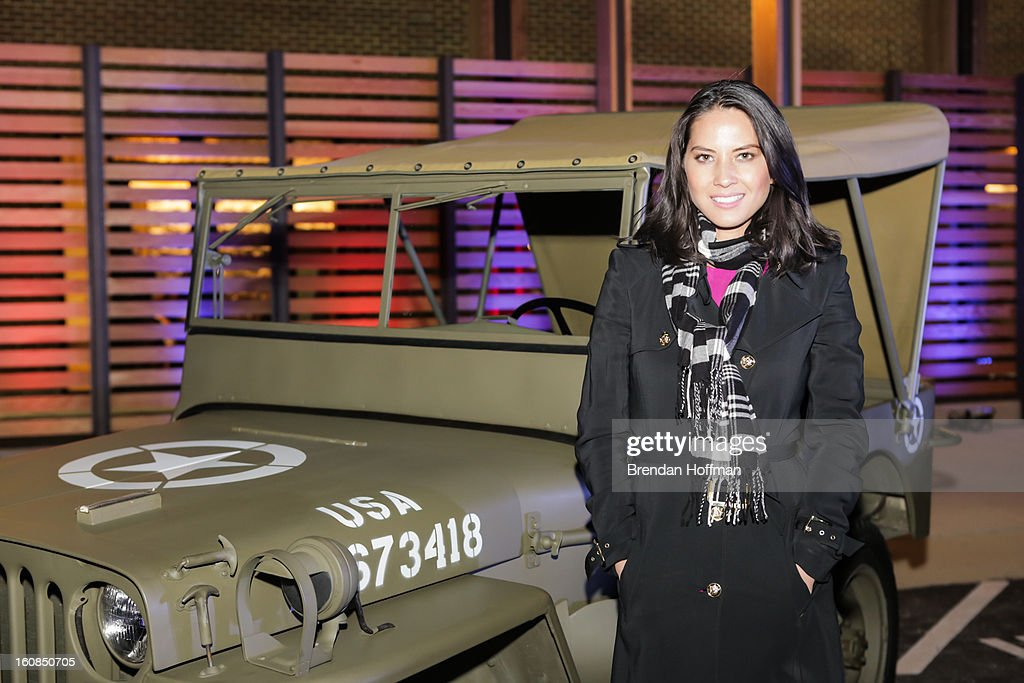 Actress Olivia Munn poses in front of a 1941 Willys MB at the launch event for Jeep Operation Safe Return at the USO Warrior & Family Center on February 6, 2013 in Fort Belvoir, VA.