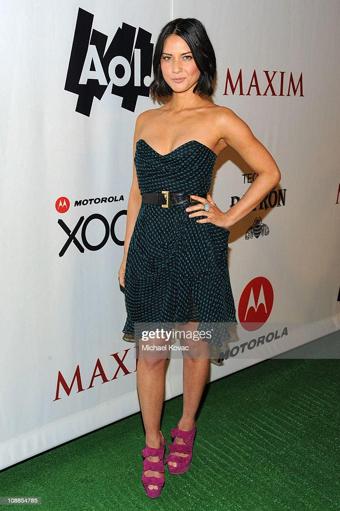 Actress Olivia Munn poses with AOL at the Maxim Party Powered by Motorola Xoom at Centennial Hall at Fair Park on February 5, 2011 in Dallas, Texas.