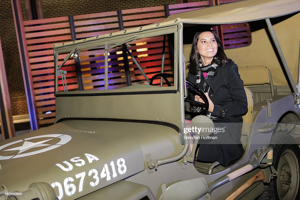 Actress Olivia Munn sits in a 1941 Willys MB at the launch event for Jeep Operation Safe Return at the USO Warrior & Family Center on February 6, 2013 in Fort Belvoir, VA.