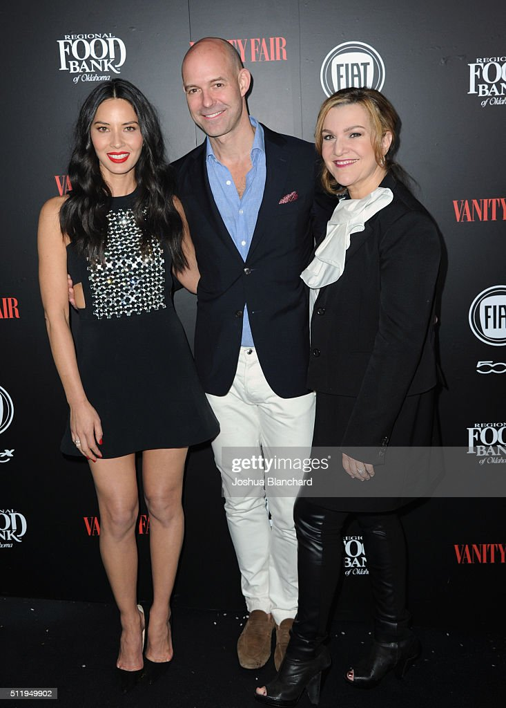 Actress Olivia Munn, Vanity Fair publisher Chris Mitchell and Vanity Fair West Coast editor Krista Smith attend Vanity Fair and FIAT Young Hollywood Celebration at Chateau Marmont on February 23, 2016 in Los Angeles, California.