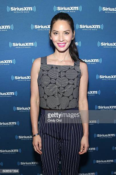 Actress Olivia Munn visits the SiriusXM set at Super Bowl 50 Radio Row at the Moscone Center on February 5 2016 in San Francisco California