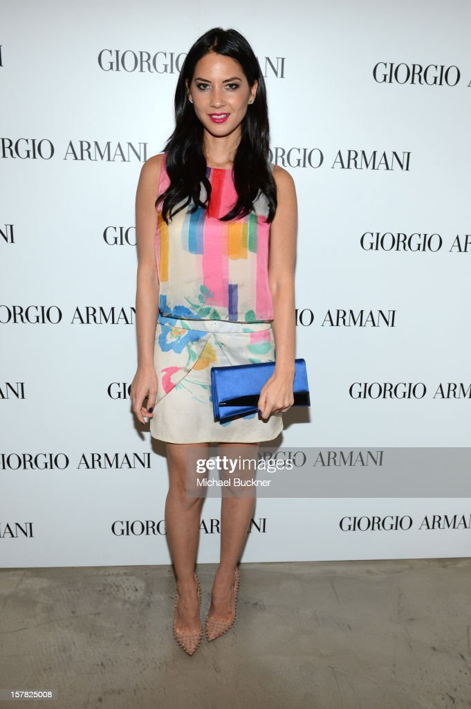 Actress <a gi-track='captionPersonalityLinkClicked' href=/galleries/search?phrase=Olivia+Munn&family=editorial&specificpeople=598969 ng-click='$event.stopPropagation()'>Olivia Munn</a>, wearing Emporio Armani attends the Giorgio Armani Beauty Luncheon on December 6, 2012 in Beverly Hills, California.