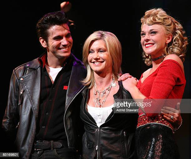 Actress Olivia NewtonJohn visits the Broadway cast of Grease with Derek Keeling and Ashley Spencer to promote Breast Cancer Awareness Month at the...
