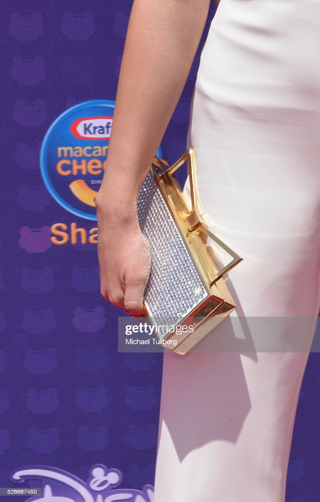 Actress Olivia Stuck, purse detail, attends the 2016 Radio Disney Music Awards at Microsoft Theater on April 30, 2016 in Los Angeles, California.