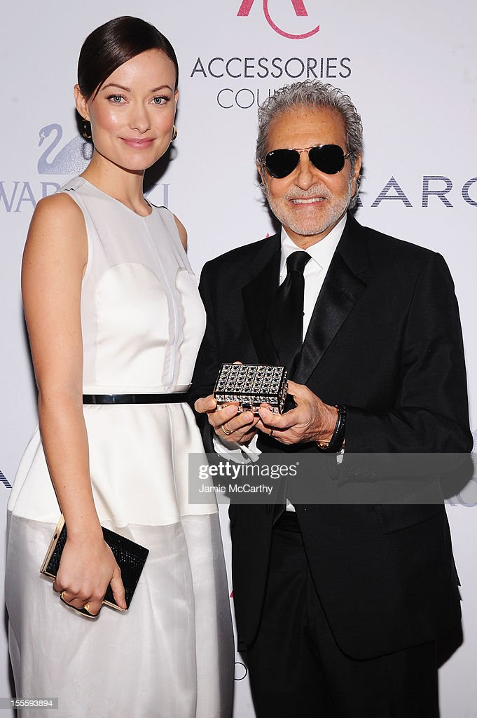 Actress <a gi-track='captionPersonalityLinkClicked' href=/galleries/search?phrase=Olivia+Wilde&family=editorial&specificpeople=235399 ng-click='$event.stopPropagation()'>Olivia Wilde</a> (L) and designer Vince Camuto attend the 16th Annual ACE Awards presented by the Accessories Council at Cipriani 42nd Street on November 5, 2012 in New York City.