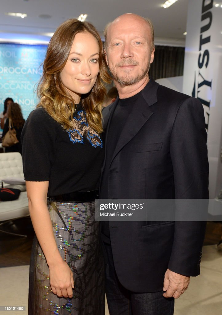 Actress <a gi-track='captionPersonalityLinkClicked' href=/galleries/search?phrase=Olivia+Wilde&family=editorial&specificpeople=235399 ng-click='$event.stopPropagation()'>Olivia Wilde</a> (L) and filmmaker <a gi-track='captionPersonalityLinkClicked' href=/galleries/search?phrase=Paul+Haggis&family=editorial&specificpeople=213967 ng-click='$event.stopPropagation()'>Paul Haggis</a> attends Variety Studio presented by Moroccanoil at Holt Renfrew during the 2013 Toronto International Film Festival on September 9, 2013 in Toronto, Canada.