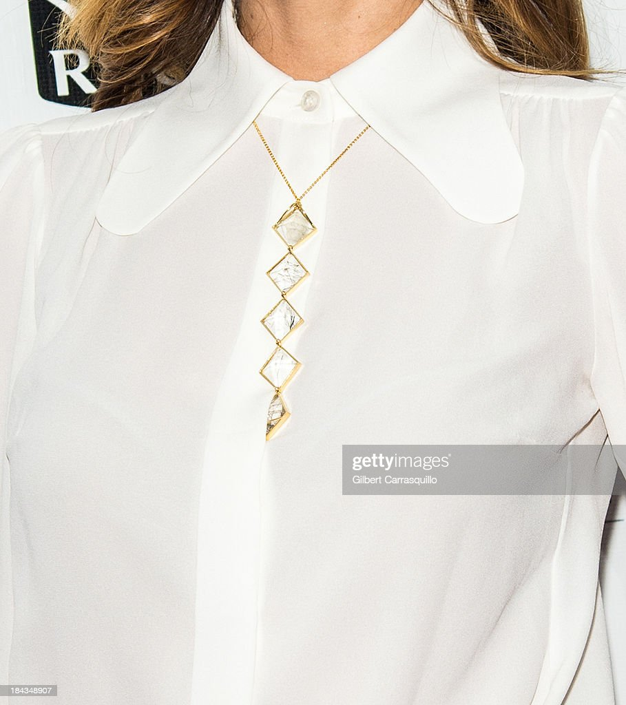 Actress Olivia Wilde (jewelry detail) attends the Closing Night Gala Presentation Of 'Her' during the 51st New York Film Festival at Alice Tully Hall at Lincoln Center on October 12, 2013 in New York City.