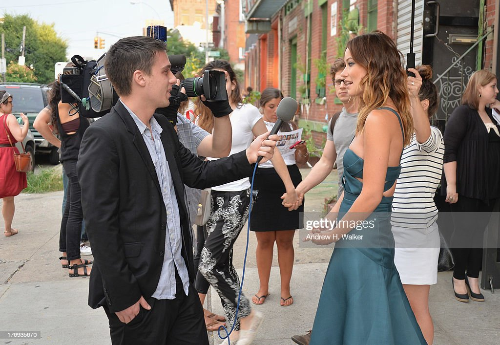 Actress <a gi-track='captionPersonalityLinkClicked' href=/galleries/search?phrase=Olivia+Wilde&family=editorial&specificpeople=235399 ng-click='$event.stopPropagation()'>Olivia Wilde</a> (R) attends the 'Drinking Buddies' screening at Nitehawk Cinema on August 19, 2013 in the Brooklyn borough of New York City.