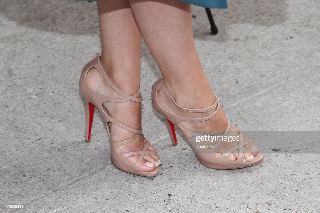 Actress Olivia Wilde (Christian Louboutin shoe detail) attends the 'Drinking Buddies' screening at Nitehawk Cinema on August 19, 2013 in the Brooklyn borough of New York City.