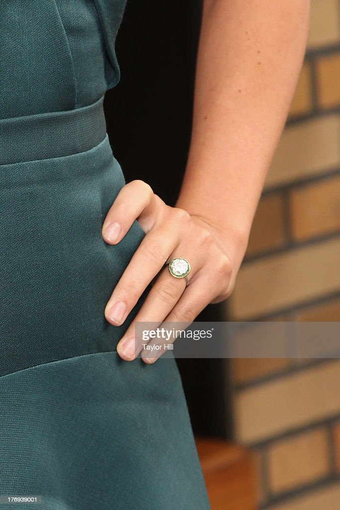 Actress Olivia Wilde (engagement ring detail) attends the 'Drinking Buddies' screening at Nitehawk Cinema on August 19, 2013 in the Brooklyn borough of New York City.