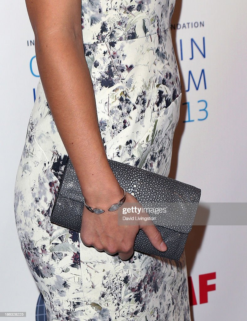 Actress <a gi-track='captionPersonalityLinkClicked' href=/galleries/search?phrase=Olivia+Wilde&family=editorial&specificpeople=235399 ng-click='$event.stopPropagation()'>Olivia Wilde</a> (torso detail) attends the IWMF Courage in Journalism Awards 2013 at the Beverly Hills Hotel on October 29, 2013 in Beverly Hills, California.