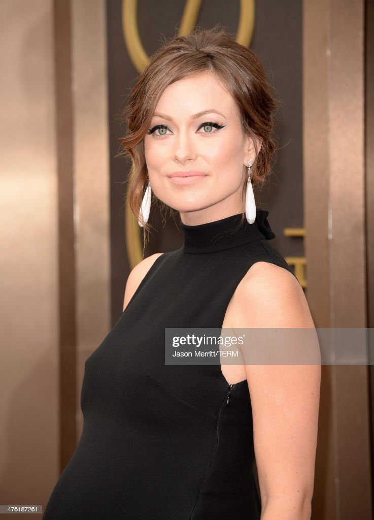 Actress Olivia Wilde attends the Oscars held at Hollywood Highland Center on March 2 2014 in Hollywood California