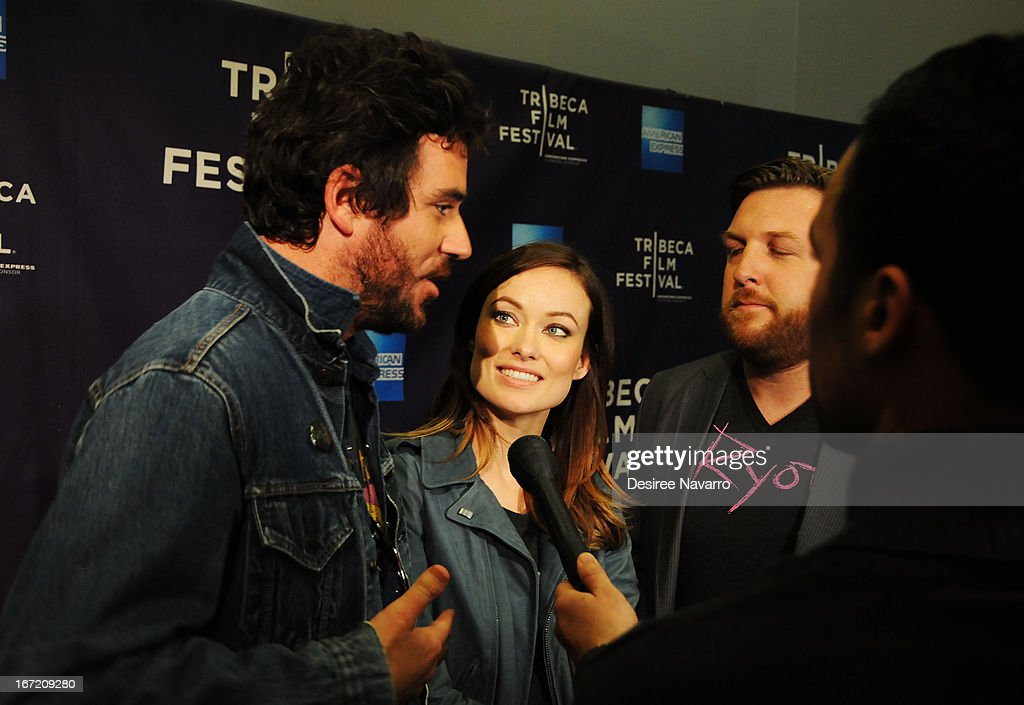 Actress <a gi-track='captionPersonalityLinkClicked' href=/galleries/search?phrase=Olivia+Wilde&family=editorial&specificpeople=235399 ng-click='$event.stopPropagation()'>Olivia Wilde</a>, director Bryn Mooser and director David Darg attend 'The Rider And The Storm' Screening during the Shorts Program - Character Witness at the 2013 Tribeca Film Festival at AMC Loews Village 7 on April 22, 2013 in New York City.
