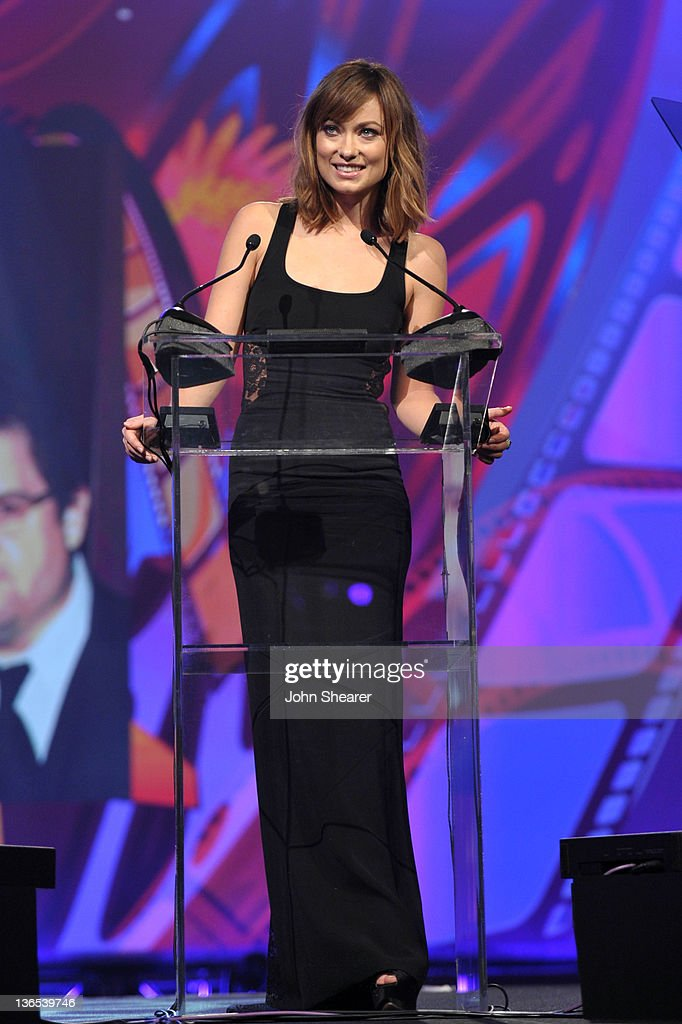 Actress <a gi-track='captionPersonalityLinkClicked' href=/galleries/search?phrase=Olivia+Wilde&family=editorial&specificpeople=235399 ng-click='$event.stopPropagation()'>Olivia Wilde</a> presents the Vanguard Award for Creative Ensemble onstage during The 23rd Annual Palm Springs International Film Festival Awards Gala at the Palm Springs Convention Center on January 7, 2012 in Palm Springs, California.