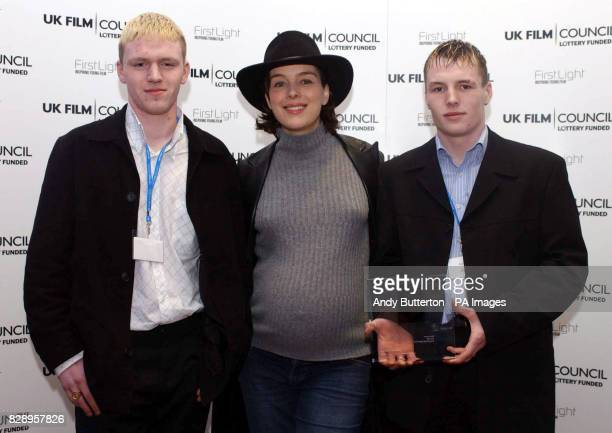 Actress Olivia Williams with Darryn Padget and David Bain from Young People Speak Out Edinburgh with their award for Best Horror for their film 'Cry...