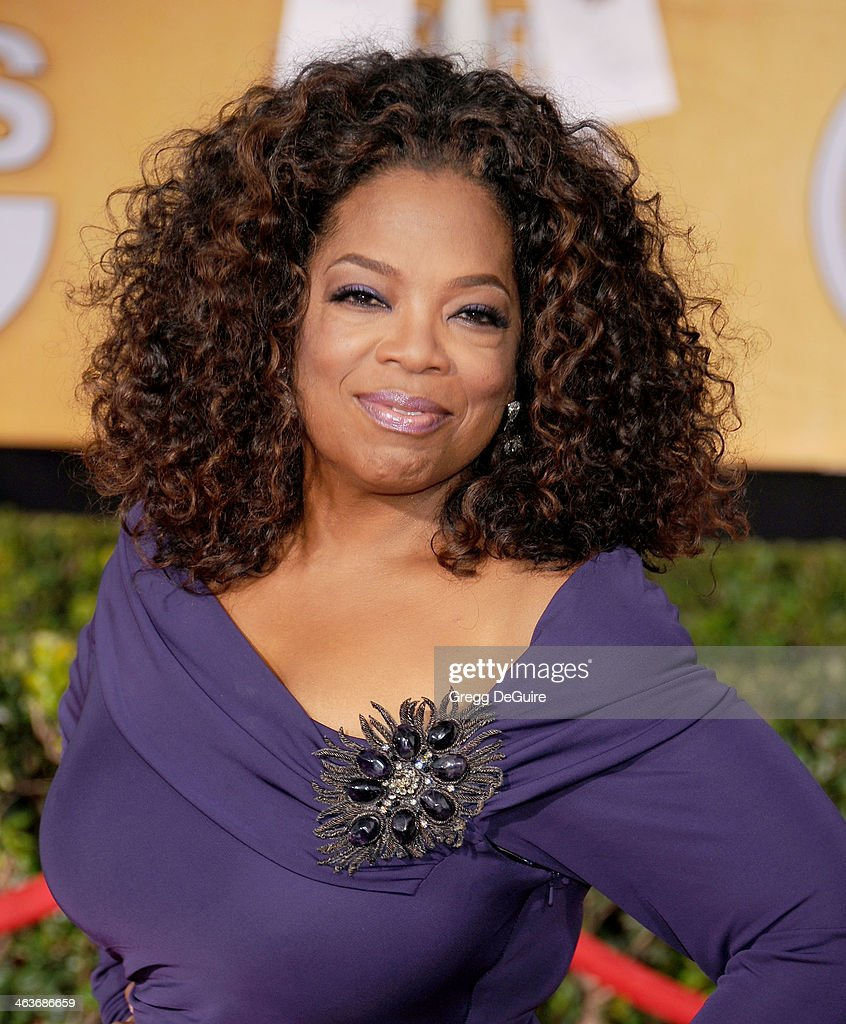Actress Oprah Winfrey arrives at the 20th Annual Screen Actors Guild Awards at The Shrine Auditorium on January 18, 2014 in Los Angeles, California.