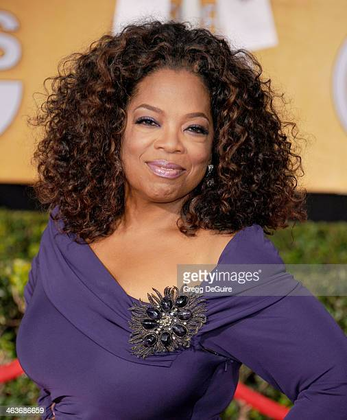 Actress Oprah Winfrey arrives at the 20th Annual Screen Actors Guild Awards at The Shrine Auditorium on January 18 2014 in Los Angeles California