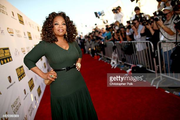 Actress Oprah Winfrey attends the 19th Annual Critics' Choice Movie Awards at Barker Hangar on January 16 2014 in Santa Monica California