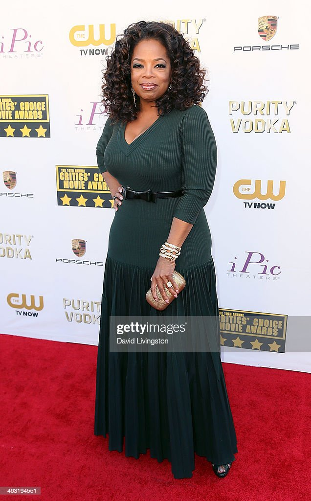 Actress Oprah Winfrey attends the 19th Annual Critics' Choice Movie Awards at Barker Hangar on January 16, 2014 in Santa Monica, California.