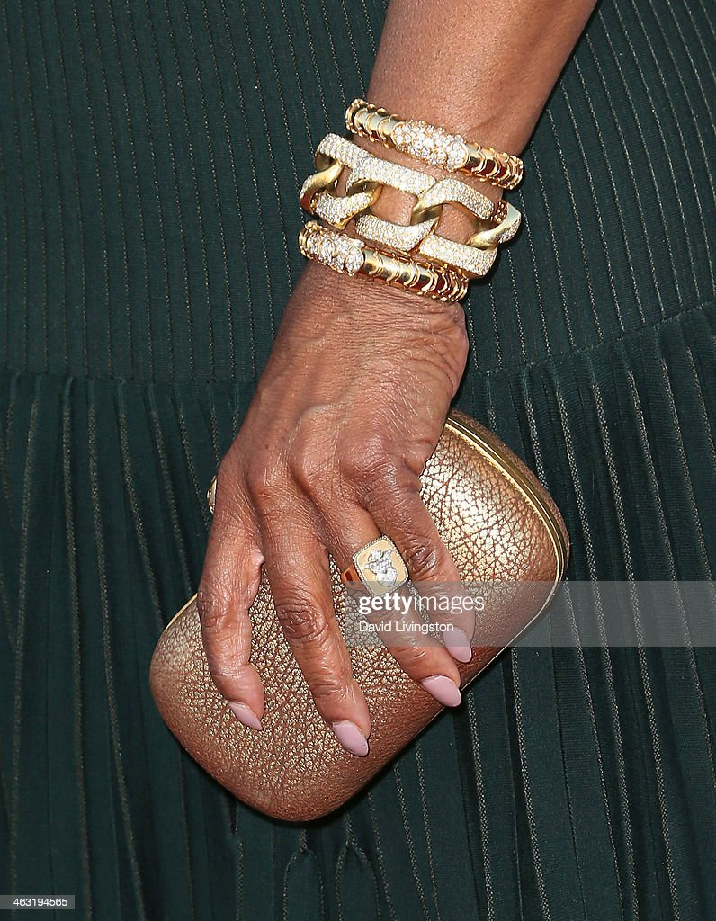 Actress Oprah Winfrey (purse & jewelry detail) attends the 19th Annual Critics' Choice Movie Awards at Barker Hangar on January 16, 2014 in Santa Monica, California.