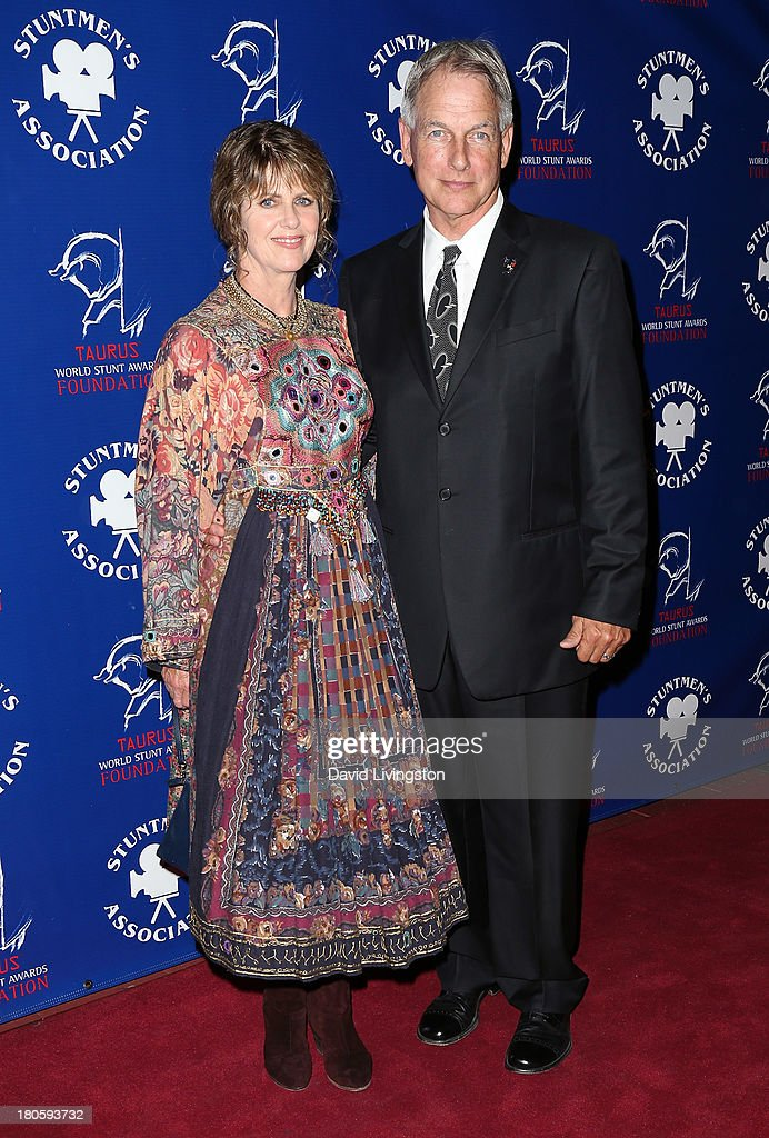 Actress <a gi-track='captionPersonalityLinkClicked' href=/galleries/search?phrase=Pam+Dawber&family=editorial&specificpeople=643517 ng-click='$event.stopPropagation()'>Pam Dawber</a> (L) and husband actor <a gi-track='captionPersonalityLinkClicked' href=/galleries/search?phrase=Mark+Harmon&family=editorial&specificpeople=208897 ng-click='$event.stopPropagation()'>Mark Harmon</a> attend the Stuntmen's Association of Motion Pictures 52nd Annual Awards Dinner to benefit the Taurus World Stunt Awards Foundation at the Hilton Universal City on September 14, 2013 in Universal City, California.
