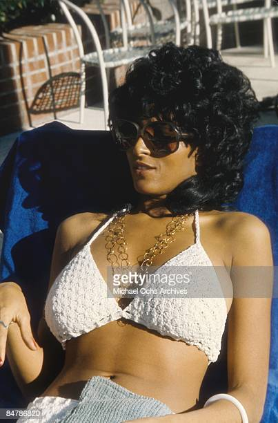 Actress Pam Grier sits by the pool circa 1975 in Los Angeles California