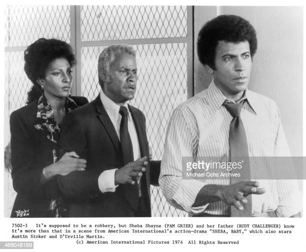 Actress Pam Grier with actors Rudy Challenger and Austin Stoker on set of the movie ''Sheba Baby ' circa 1975